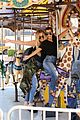kourtney khloe kardashian ride a merry go round together 21