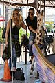 kourtney khloe kardashian ride a merry go round together 31