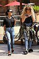 kourtney khloe kardashian ride a merry go round together 35