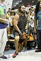 jason momoa biceps are bulging all over on the climbing wall 08