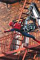 tom holland performs his own spider man stunts on nyc fire escape 16
