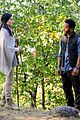jaimie alexander crawls around the woods while filming for blindspot 03
