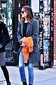 dakota johnson orange jacket soho walk 11