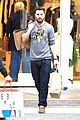 aaron taylor johnson gets in some christmas shopping 05