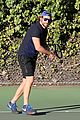 bradley cooper works on his serve on the tennis court 06