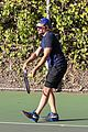 bradley cooper works on his serve on the tennis court 09
