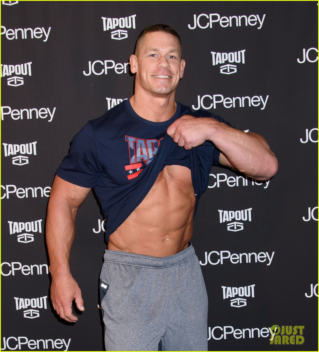 john-cena-flashes-his-rock-hard-abs-and-bulging-biceps-08.jpg