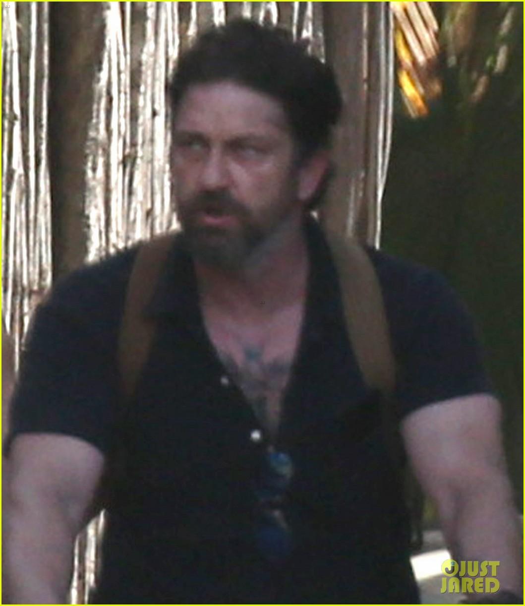 gerard butler puts tattoos on display in cancun with morgan brown 083863431