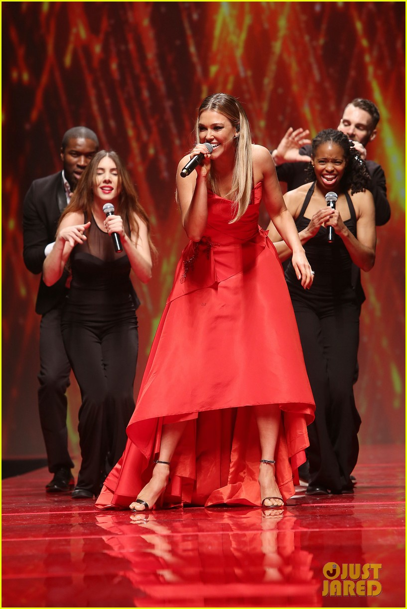katie holmes models marchesa in red dress show for nyfw 053856468