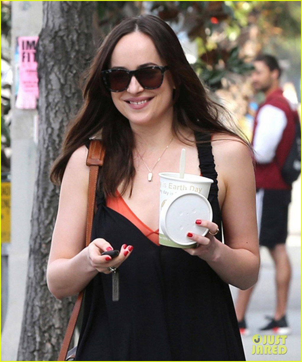 dakota johnson is all smiles alongside her personal trainer 063876547