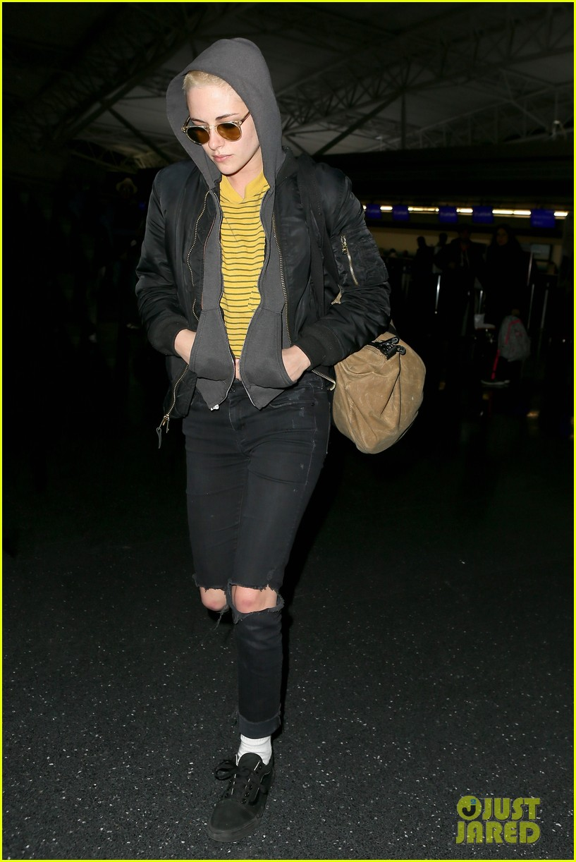 kristen stewart covers up new buzzed hair arriving in nyc 033871680