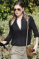 ellen pompeo heads to a meetng in a 04