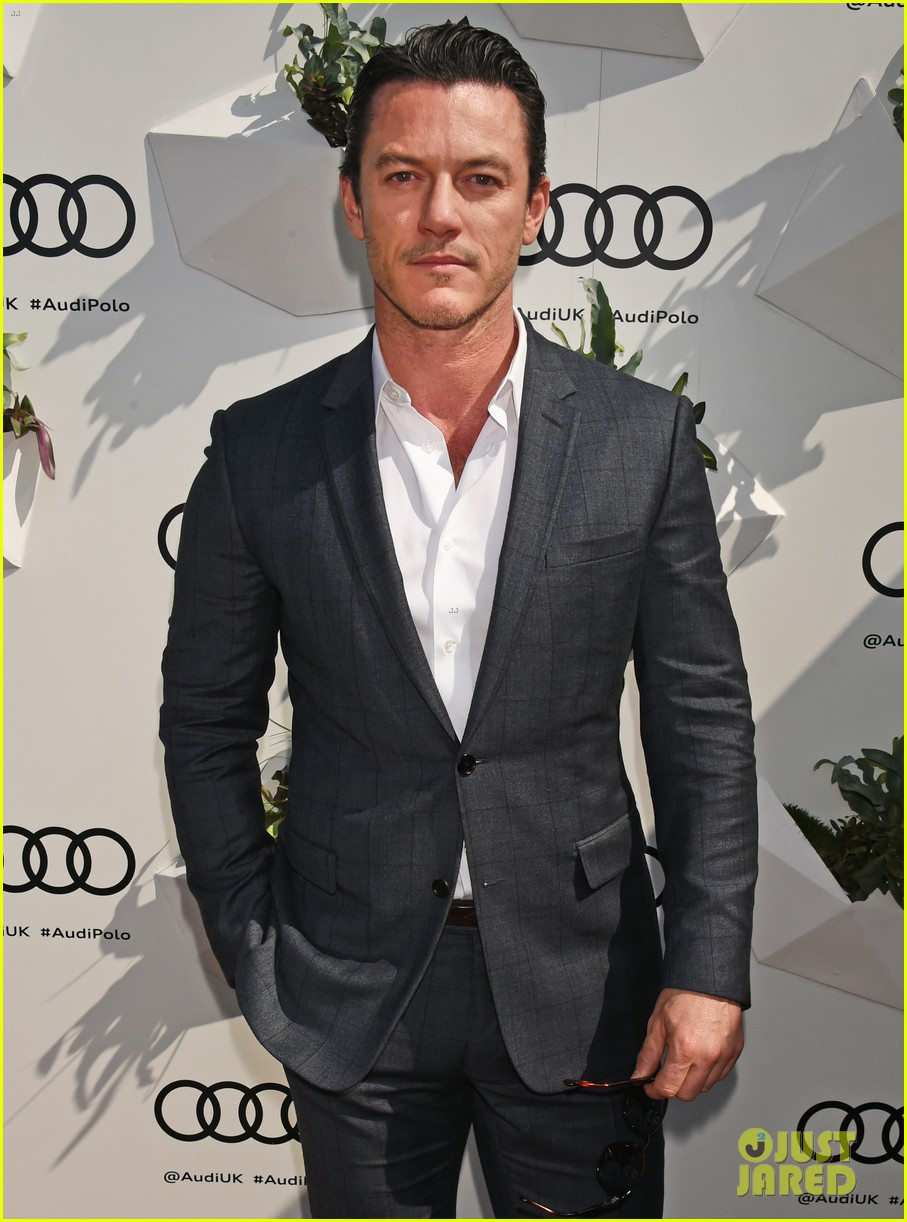 emma stone catches a polo match with luke evans 023896459