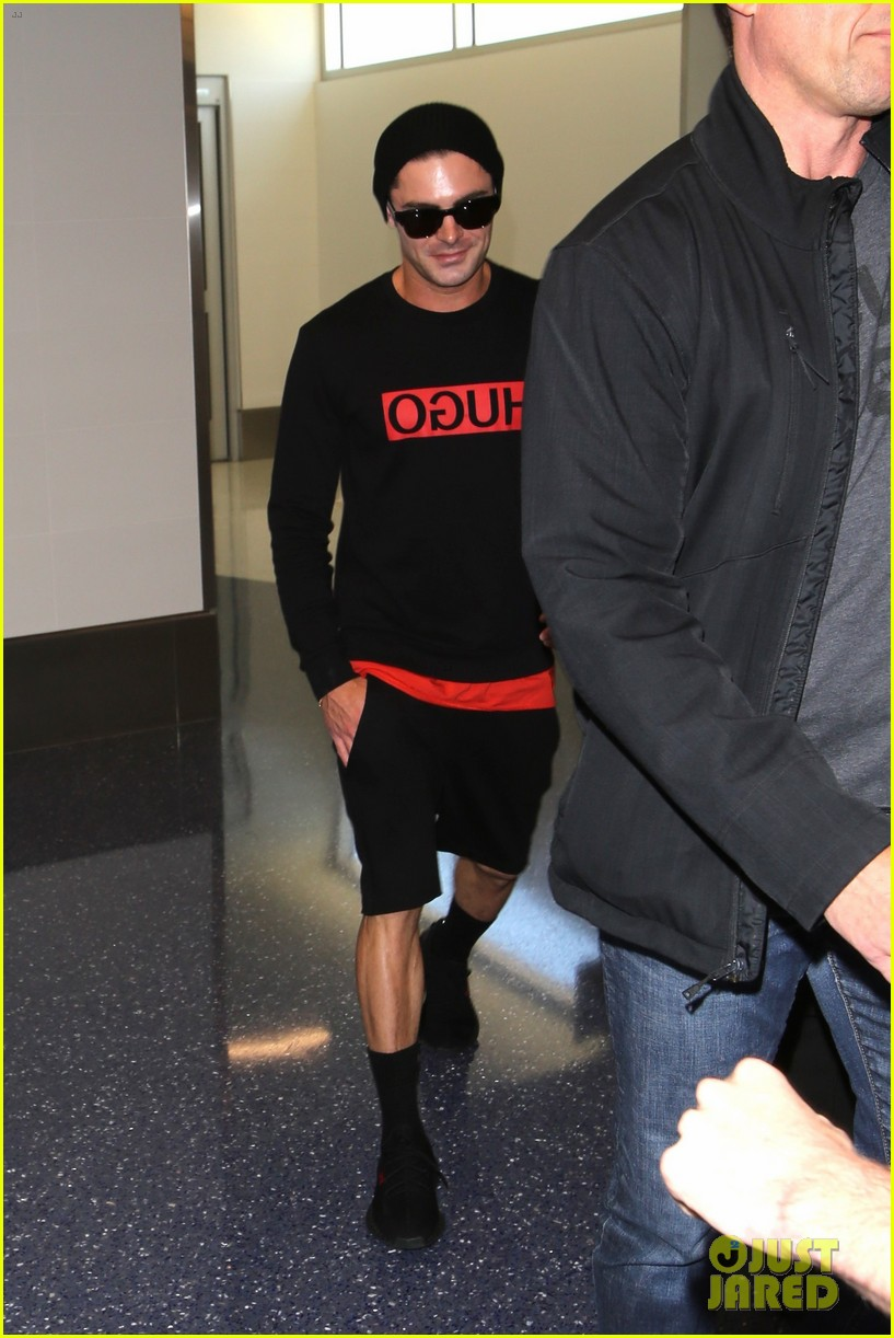 zac efron lax airport black shirt hat 043897683