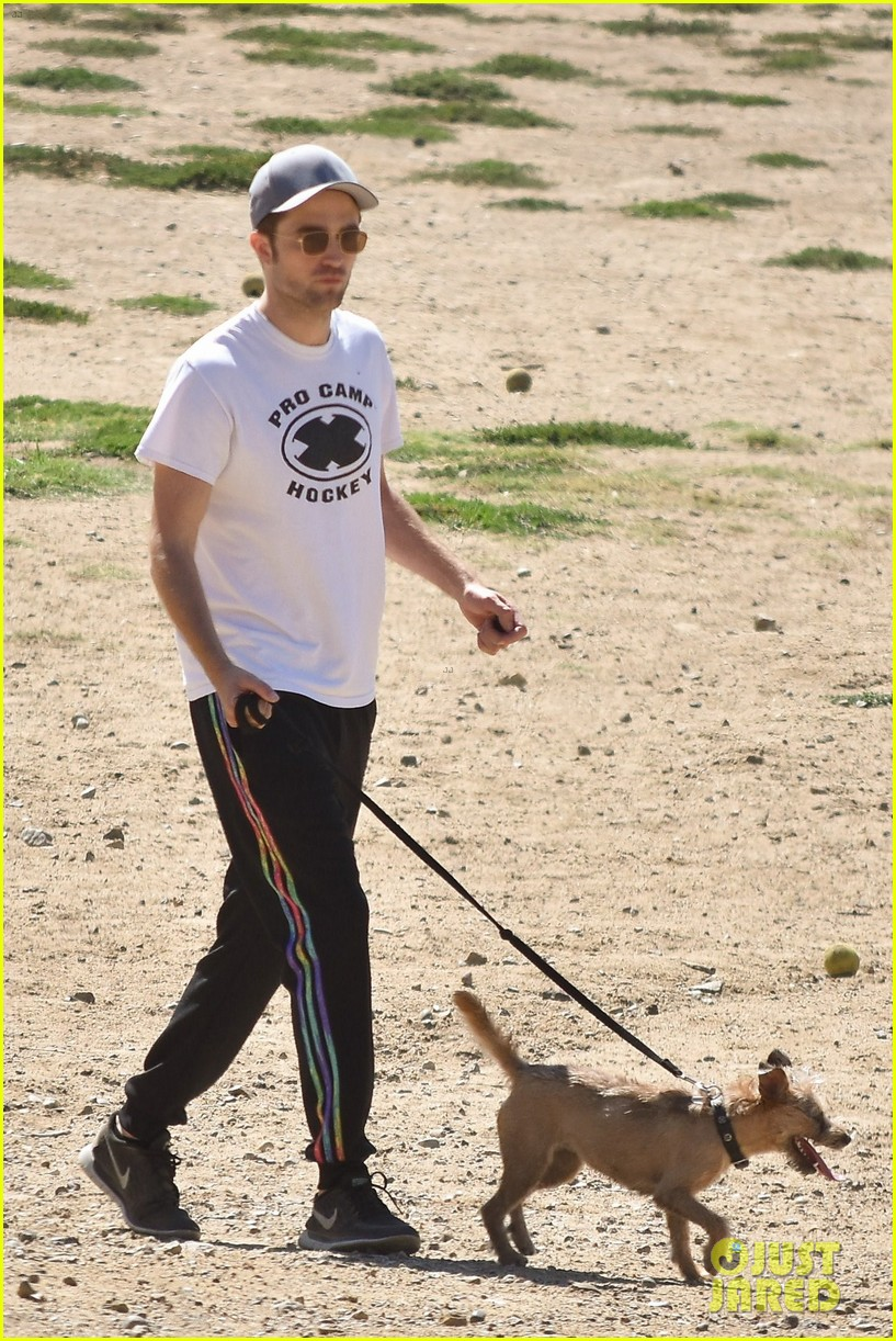 robert pattinson takes his pup for a walk 053921198