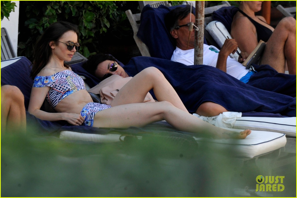 lily collins lounges by pool in two piece swimsuit 023929123