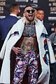 conor mcgregor goes shirtless during press conference with floyd mayweather jr 22