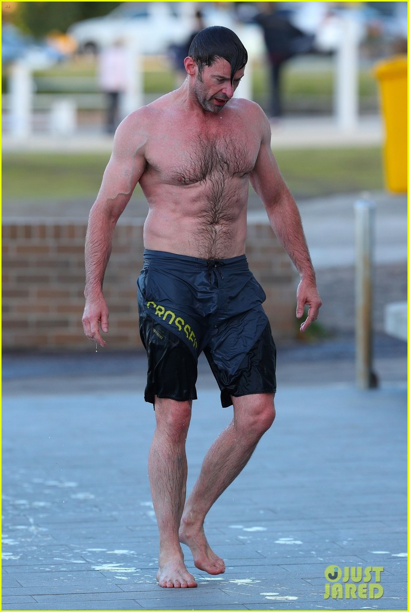 hugh jackman runs shirtless on the beach with his ripped muscles 013935917