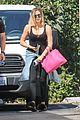 khloe kardashian flaunts her toned abs in black bodysuit 05