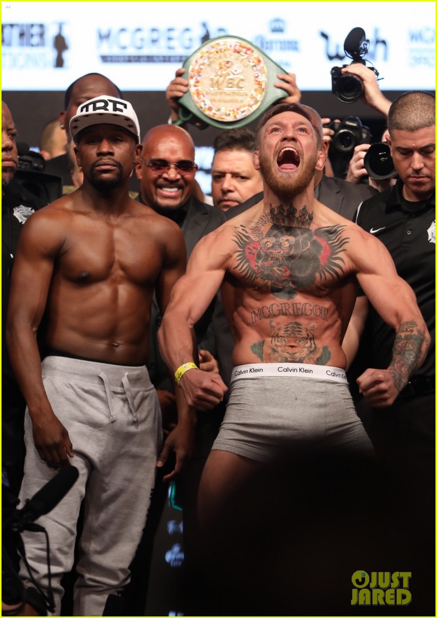 conor mcgregor and floyd mayweather face off at the weigh ins ahead of fight 033945648