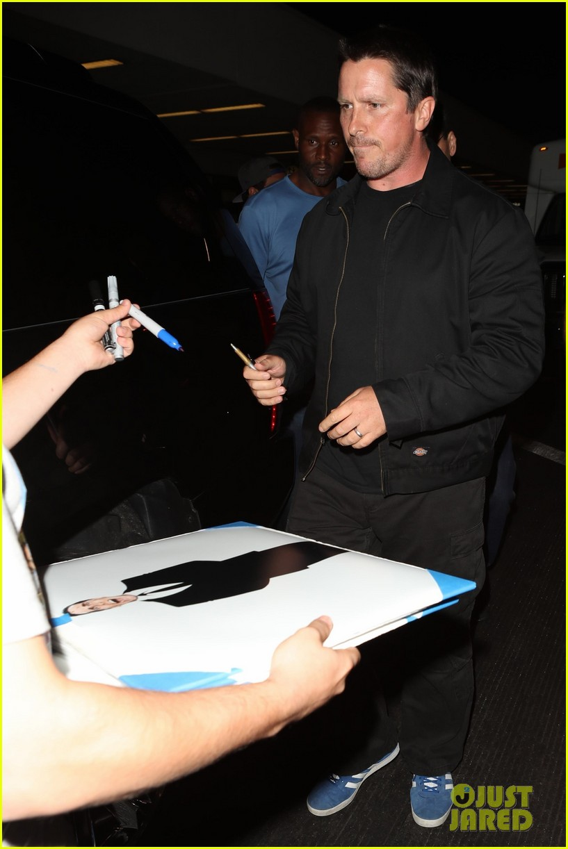 christian bale shows off his filler figure at lax 103956769