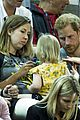 prince harry makes funny faces for a baby at the invictus games 12