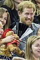 prince harry makes funny faces for a baby at the invictus games 16