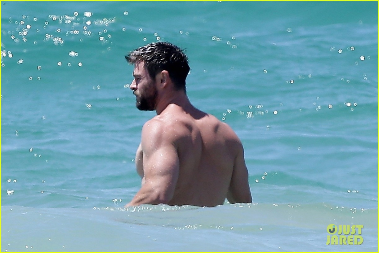chris hemsworth goes shirtless at beach in australia 133972253
