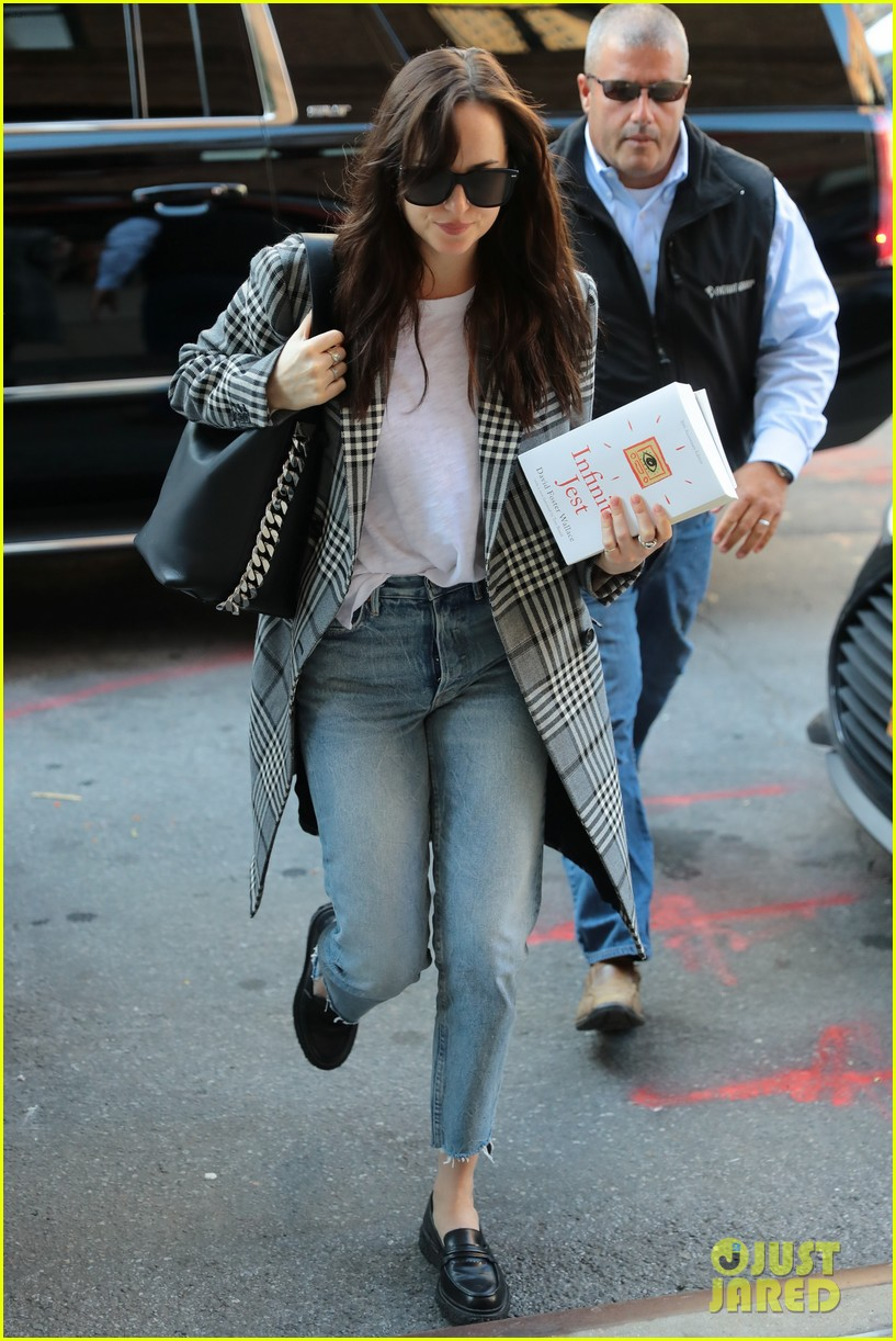 dakota johnson sports long plaid coat while out in nyc 023974707
