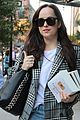 dakota johnson sports long plaid coat while out in nyc 01