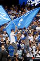 mila kunis ashton kutcher wave dodgers flag 01