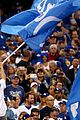 mila kunis ashton kutcher wave dodgers flag 08