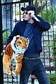 garrett hedlund carries giant stuffed tiger around the neighborhood 20