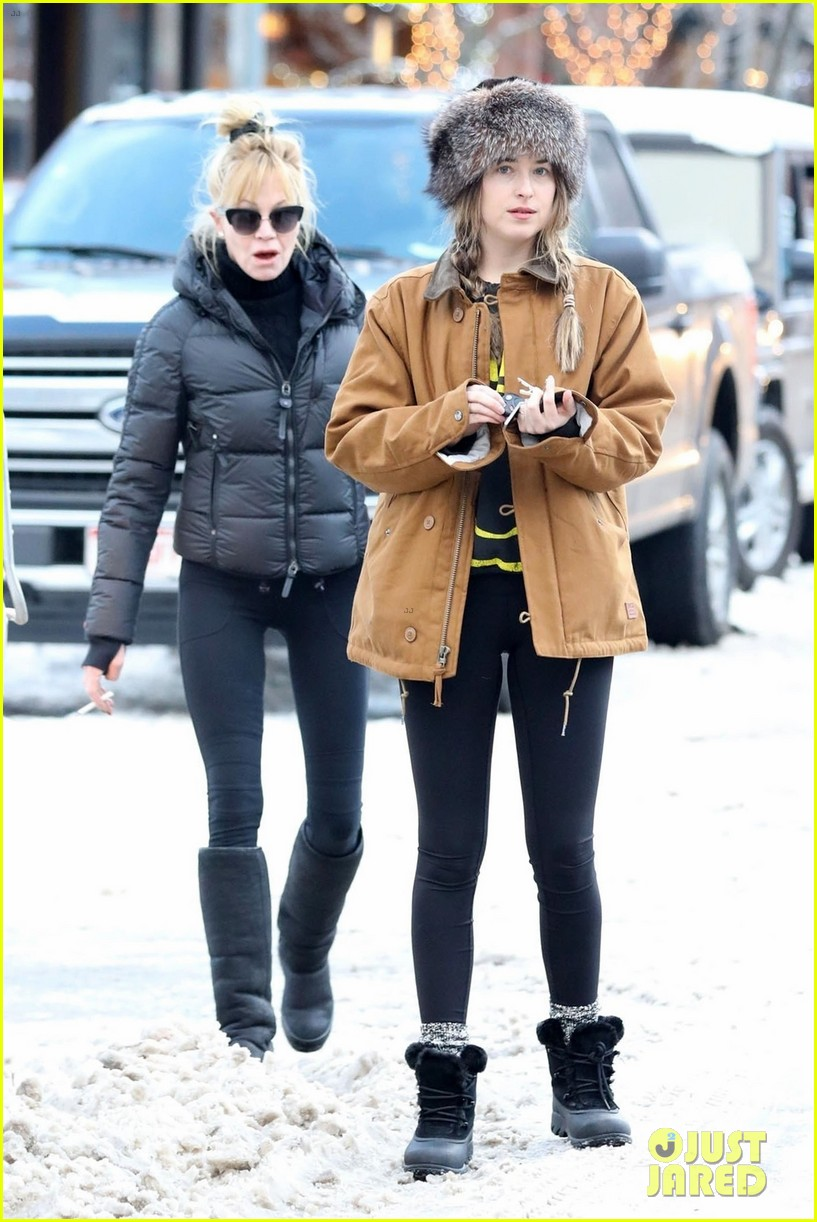 dakota johnson mom melanie griffith hold hands in aspen 014004911