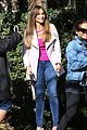 sofia vergara is pretty in pink while shooting modern family scene with ed oneill 04