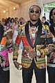 migos match in colorful versace suits and major bling at met gala 2018 05