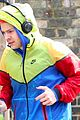 harry styles sports colorful jacket while jogging in london 04