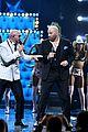 john travolta teams up with pitbull for live performance at univisions premio lo nuestro 2020 02