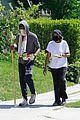 chadwick boseman walks with a walking stick 20