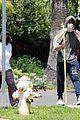 chadwick boseman walks with a walking stick 24