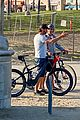 gerard butler rad cap bike ride beach 03