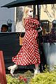 emma roberts shows off bump mag stand run 24