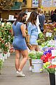 emily ratajkowski cradles her growing baby bump shopping for flowers 24