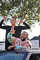 chrissy teigen john legend hang out of car celebrate biden 24