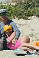 alessandra ambrosio richard lee touch tongues beach day 03