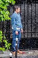 lily collins caught in rain with lucas bravo emily in paris 11
