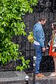 lily collins caught in rain with lucas bravo emily in paris 19
