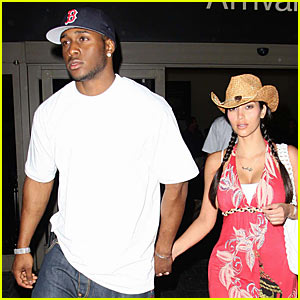 Kim Kardashian & Reggie Bush Return From Mexican Paradise