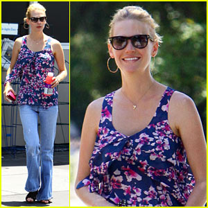 January Jones Gulps Vitamin Water