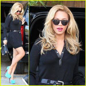 Beyonce Teeters in Turquoise Heels